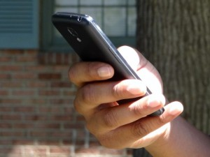 MALE HAND HOLDING SMARTPHONE By DodgertonSkillhause - morguefile.com